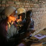 Women get contraceptive pills from IPPF staff.