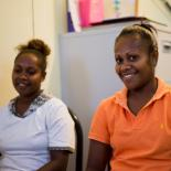 Two girls smiling. Vanuatu Family Health Association