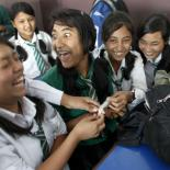 Young people laughing during condom demonstration