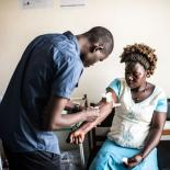 25-year-old Dorcas Lanyero gets blood test during a visit to the RHU clinic in Gulu. Lanyero was suffering from abdominal pain but received a full range of tests while she was there.