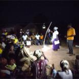 A night meeting in Ghana held using solar lanterns