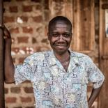 John, a VODA-supported community volunteer, counsellor and catechist, at his home near Kasawo, Uganda.