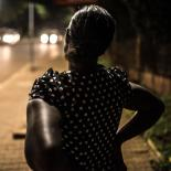 Deborah, a sex worker and beneficiary of the Lady Mermaid's Bureau project, at night in central Kampala.