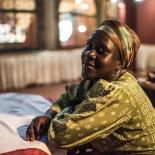 Joan, a former sex worker and beneficiary of the Lady Mermaid's Bureau project, photographed in a hotel in central Kampala.