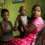 Mother will children at clinic