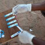 A HIV test being administrated in a rural village