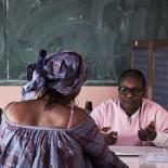 Midwife Ndoye Yacine Touré speaks with client Maguette Mbou, 33, during a free consultancy by ASBEF at School Seydina Limamou Laye in Dakar, Senegal.