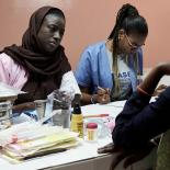 A midwife talks to a client in Senegal