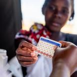 Woman receiving contraceptive pills after Cyclone Idai, Mozambique