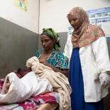 Midwife Rewda Kedir examines a newborn baby and mother in a health center outside of Jimma, Ethiopia