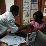 A woman received healthcare in Cameroon