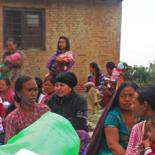 Nepalese women sit on the ground