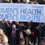 Women marching for women's health rights, carrying an IPPF banner