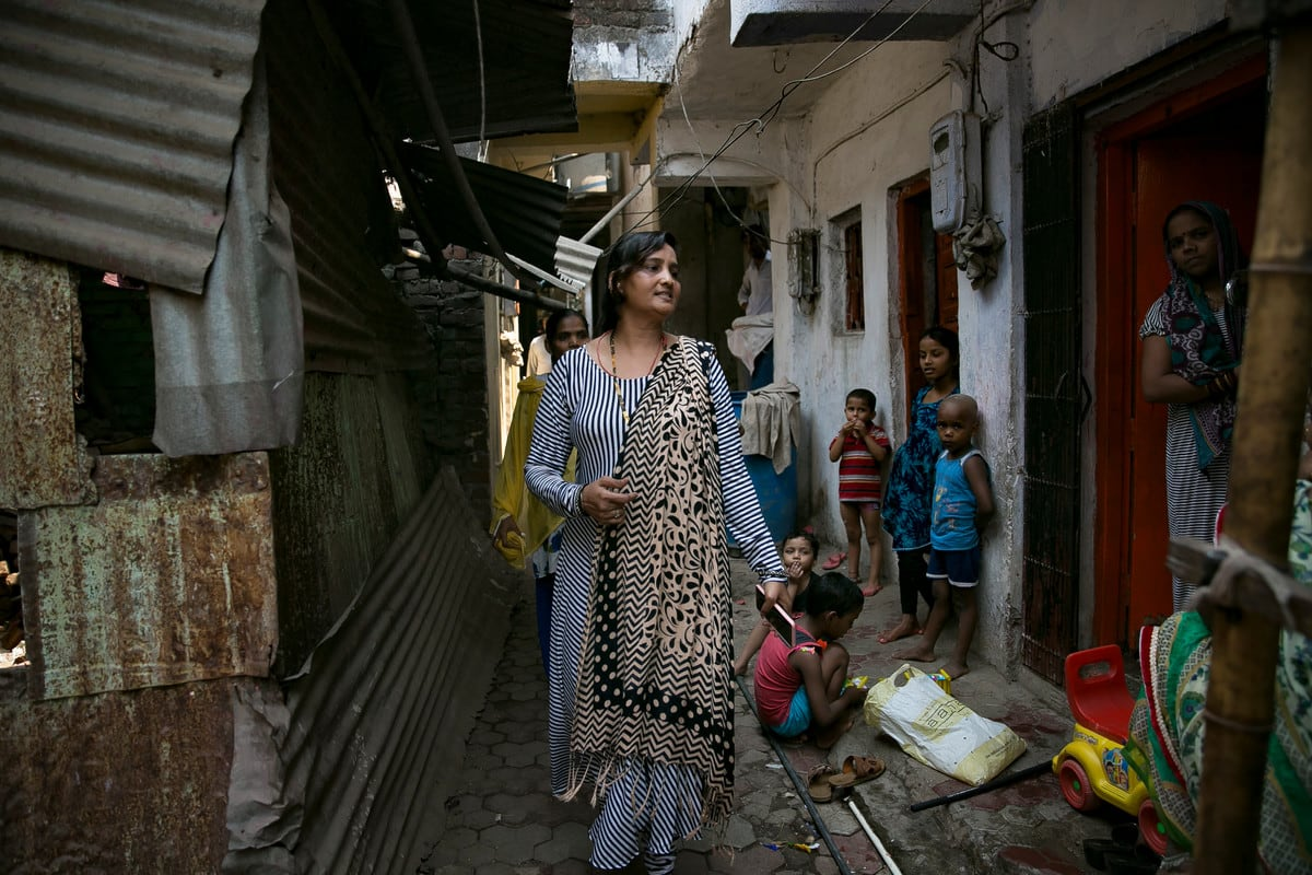 Shajahan is a link worker in the nearby Muslim district, where women pack into a house in the narrow village lanes to wait to speak to her